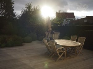 A teak deck with table outside at sunset