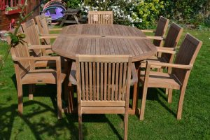 teak lawn furniture set with chairs and a table