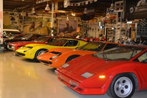a line of classic sports cars in a garage